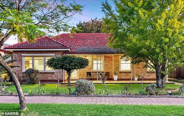 Nearly half of Australia expect interest rates to rise before 2024 to stop a house price bubble, a survey shows.  Pictured is a house in Glenelg in Adelaide