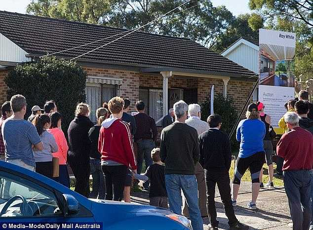 Record interest rates are a time bomb for a million home borrowers, as mortgage costs rise well before 2024. Pictured is an auction in Sydney